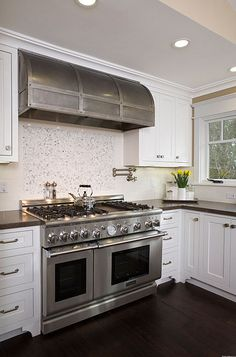 Double ovens, range hood - when it comes to cooktops - this would supply enough burners and who would not love a double oven -  Water supply for serious cooks is an essential is it not?!