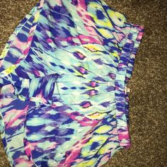 Super soft colorful shorts medium I over these shorts but it's time to pass these along. Super lightweight and comfortable shorts. Can be worn high waisted. Medium but fits either small or medium. Shorts Bermudas