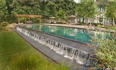 Baker A long rectangular pool with a great water feature built right into the side.