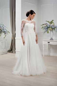 Elizabeth Passion 2014. Model E-2779-T. Simple dress with lace sleeves - might be worth trying on somewhere.