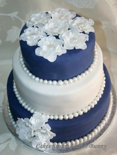 Blue, white and pearl wedding cake