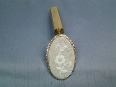 Vintage Lipstick Holder with Mirror that has a Micro Beaded Flower Pattern on Etsy, $59.00