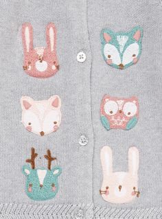 Add to their knitwear collection with this charming grey cardi. Knitted in rich cotton, this piece features cable stitch detailing, glitter button fastening and accented in enchanting woodland animal embroidery. Layer over cotton pieces and outfits. Grey animal embroidered cardigan Long sleeve Knitted Cable stitch detail Button fastening Pure cotton Sparkle detail Woodland animal embroidery Keep away from fire