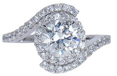 Ziamond Micro Pave Halo Cubic Zirconia Solitaire Engagement Ring features a one carat 6.5mm round surrouned by a halo of micro pave set round cubic zirconia.