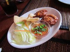 Corn cakes, prawn crackers and dipping sauce at Spice and Rice in Chalk Farm, London