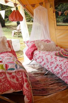 Glamorous camping.....Glamping!  Colorful bedding, braided rugs. Read more on how to glamp. http://blogs.lowellsun.com/daleydecor/2014/07/10/decorating-in-glamping-style/