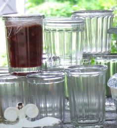 french jam jars - I use them as drinking glasses. Nothing quite like watching one bounce without breaking when your 8 yo drops it!
