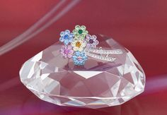 """Hope everyone had a great weekend!  Annaleece continues their #TenDaysofBeauty with a popular brooch. #jewelry #gift industry    With its vibrant colors, Annaleece's """"Sweetheart Bouquet"""" brooch is the perfect accessory to spruce up any outfit.  An Annaleece original design, its Rhodium finish with aquamarine, light sapphire, light rose, rose, jonquil, topaz, light amethyst, amethyst, emerald, peridot, sapphire and clear SWAROVSKI ELEMENTS will add a splash of color to any look."""