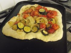 Freshly made roasted vegetable pizza made during one of our cooking sessions