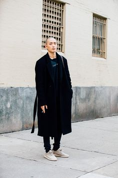 """Korean model Sung Jin Park wears a black jacket Cav Empt shirt and adidas YEEZY Boost 350 """"Oxford Tan"""" shoes during New York Fashion Week Men's..."""