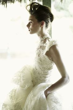 Wedding dress couture. Lace, high neck, hair.