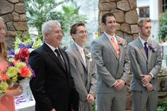 Purple ties and boutonnieres for the groomsmen, peach for the man of honor and white for the groom