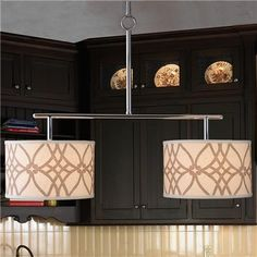 For over kitchen table; Create Your Look Island Chandelier (shade separate); Would do in a Chocolate Bronze Finish; We can do plain linen shades