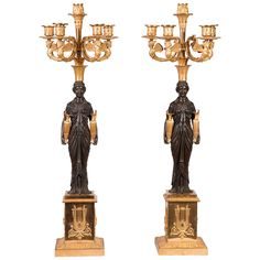 Pair of French Empire Candelabras | From a unique collection of antique and modern candle holders at https://www.1stdibs.com/furniture/decorative-objects/candle-holders/