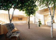 KAMP Arhitektid creates tree-filled office within former factory