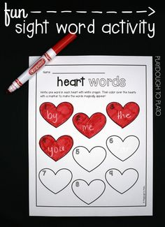 FREE sight word activity for kids! Write the words in white crayon and then color the hearts with marker to make them magically appear. So simple and fun! This would be a perfect idea for Valentine's Day.