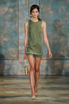 Same goes for a delightful embellished trim linen tunic and shorts set in an earthy green that go great with a tan—the kind achieved on a nice, long get-a-way.   - HarpersBAZAAR.com