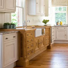 natural wood cabinets mixed with white cabinets