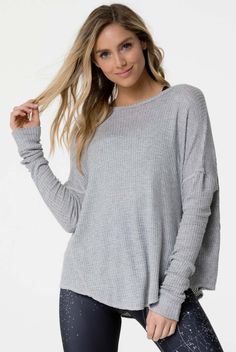 Bound to be your new favorite top, the Raglan Pullover Top from Onzie brings sexy style to the studio, street, and everywhere in-between! Featuring a Ribbed Heather Grey hue with a loose fit, this long sleeved top feels like pajamas bur looks like cute at Long Sleeve Tops, Bell Sleeve Top, Patterned Leggings, Ribbed Fabric, Bra Tops, Street Style Women, Everyday Fashion, Heather Grey, Pullover