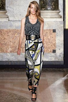 Ditch the party dress during your next night out for an ultra-cool, mixed print alternative to evening wear. To break up competing patterns, invest in a bold belt like the one shown in Emilio Pucci's spring '14 show for an edgy look that flows together flawlessly. Finish off your ensemble with a sky-high sandal that won't cramp your style on the dance floor!