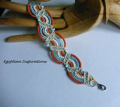 Micro macrame bracelet. Hemp bracelet beaded in coral turquoise and white.