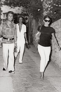 Giancarlo Giammetti with Valentino and Jacqueline Kennedy Onassis in Capri in 1971. [Photo Courtesy of Assouline]