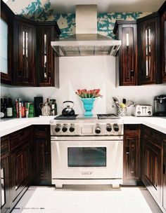 love the white backsplash and then wallpaper around the top