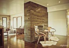 reclaimed wood (?) double sided fireplace wall.
