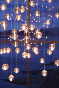 Bubble Chandelier - I bet I could make these using the glass ball idea since I know how to wire a pendant lamp- many little lamps on one circuit. Or battery operated mini LED lights in each? Suspended Lighting, Outdoor Lighting, Bocci Lighting, Wedding Lighting, Luxury Lighting, Interior Lighting, Hanging Lights, Fairy Lights, Floating Lights