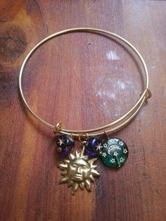 Check out this item in my Etsy shop https://www.etsy.com/listing/241051364/bonnie-angie-bangle-moon-and-back