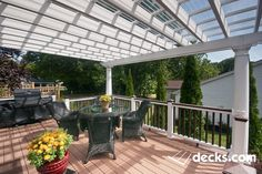 This small deck is covered with fiberglass columns. To keep it dry a double panel plexiglass is added. Pergola Designs, Deck Design, Fiberglass Columns, Outdoor Spaces, Outdoor Living, Cedar Deck, Deck Pictures, Deck Builders, Covered Decks