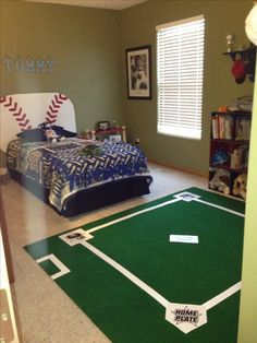 DIY baseball field rug for baseball lovers room! Went to Menards and got 6' x 7' golf green. Used white duck tape to create baselines and dugout. Got the bases at dollar tree and glued them to the field. Total cost $20 - my 5 year old loves it. Great bday gift!