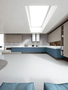 Matt Fine Grey and Petro Blue laquered doors. Corian® Glacier White top. #ArritalCucine #Kculture #modern #kitchen #Ak04