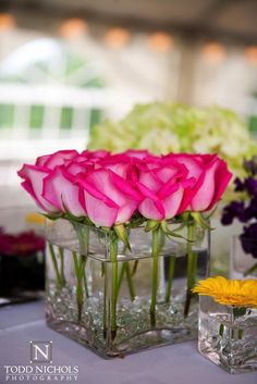very pretty wedding centerpiece, but I would have the orange/yellow (fall) color roses instead