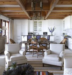 wood beam ceiling with white kitchen | Natural | Suzanne Kasler
