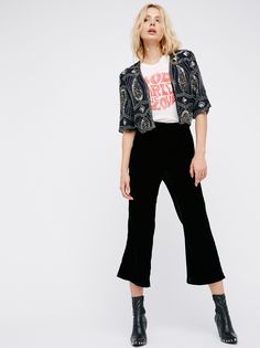 Cropped Sequin Jacket | Cropped to the natural waist this boxy and flowy jacket is heavily embellished with allover bead and sequin detailing. Three-quarter length wide sleeves. Lined.