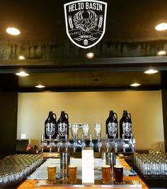 Helio Basin Brewing is a craft brewery located in Phoenix, AZ that produces a wide range of high-quality refreshing beer. Downtown Phoenix, Brewing Co, Brewery, Basin, Liquor Cabinet, Gallery, Table, Furniture, Home Decor