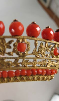 Close up of Napoleonic era tiara from France early 1800s...Gilded floral filigree brass is set with hand cut faceted natural coral beads.