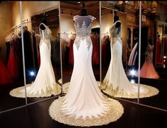 Ivory/gold formfittng Mermaid Pageant or Prom Gown with Gorgeous Embroidered Illusion Bodice and Sweeping Train at Rsvp Prom and Pageant, Atlanta, GA