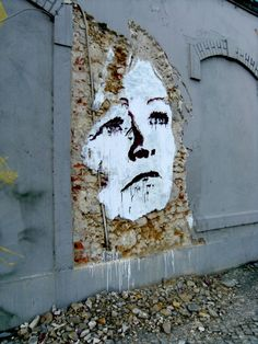 Alexandre Farto, better known as Vhils, is a street artist who creates large-scale portraits by scratching the plaster out of the walls of dilapidated buildings.