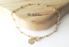 This delicate gold anklet features a high quality 14K gold filled satellite dew drop chain and is finished with a gold filled spring clasp and a tiny gold disc so that your anklet is the most stylish accessory for every outfit.  ♥ Can be made as a bracelet or an anklet. Delicate Gold Anklet Bracelet Ankle Bracelet  Christmas Gift for Women Layering Jewelry by TheGoldBar