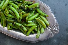 Seared Sugar Snap Peas | Posted By: Elise Bauer | With this method of cooking snap peas, you try to strike a balance between letting the peas sit so they get a little bit of sear, and tossing them, so they get all get cooked evenly and none of the peas get too charred. Just get the pan and oil good and hot before adding the peas, so you cook the peas quickly. | From: simplyrecipes.com