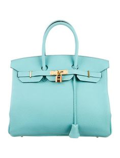 From the 2015 Collection. Blue Atoll Clemence leather Hermès Birkin 35 with gold-plated hardware, dual rolled top handles, tonal leather lining, dual pockets at interior walls; one with zip closure and turn-lock closure at front flap. Blind stamped T from 2015. Includes lock, keys, clochette, box, dust bags and rain jacket. Shop authentic designer handbags by Hermès at The RealReal.