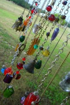 Wind chimes made of chains and sparkly jewels. I think a single bejeweled chain would be sparkly nice in the garden. Garden charms!