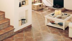 Baldosas cerámicas para suelos de efecto envejecido, una amplia gama de posibilidades para la decoración de casas de campo, ambientes de salón y habitaciones gracias a la personalidad y el estilo de los pavimentos decorativos y las piezas especiales para el diseño de escaleras  AMBIENTEREALIZADOCON606INCA,TAC0606INCAPULIDO8,2x8,2,TACOPULIDO16,7X16,7,CNF.606INCAPULIDA16,7X33,3PELDAÑOVUELTA606INCA
