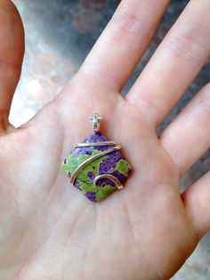 Stichtite cab tension set in hand forged polished sterling silver pendant