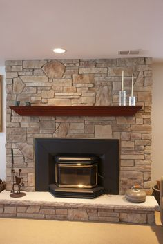 prairie style mantles | rock faced limestone. Separately a new high efficiency insert was ...