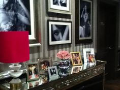 Victorias secret london. grey stripes, gallery wall, sexy furniture, lots of pictures, lamp!!