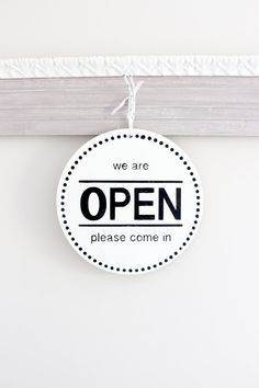 Business/Store Sign: Open/Closed with a modern design. THIS SIGN: *Measures 10 round and 1/8 thick. (Very light weight) *Available with jute or white ribbon for easy hanging (Choose in drop down when ordering.) *Sample sign is done in Bright White with Black for the text The front of this sign is We are Open, Please Come In and on the reverse side Sorry, we are Closed Please come back later. Great sign for any business to hang on the door or in the window. This sign is completely hand pai...