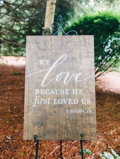 we love because he first loved us rustic wedding sign | Photography: Perry Vaile Photography